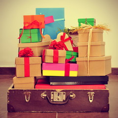 gifts in an old suitcase, with a retro effect