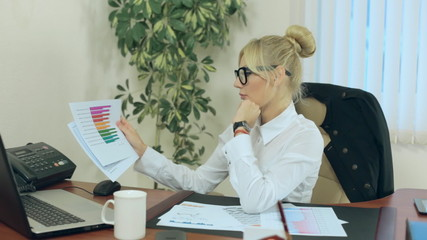 Business woman working with reports on progress made