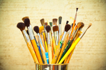 Paint brushes. instrument of the artist. photo toned yellow