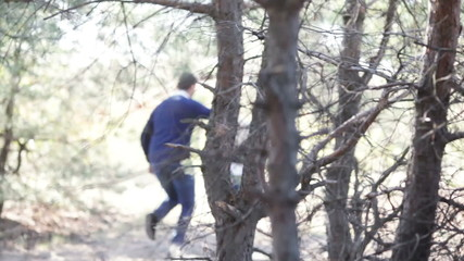 Couple running among wood CU