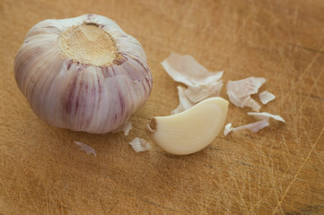 Whole garlic head with peeled garlic segment