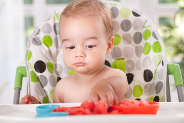 Baby eating watermelon with hands