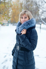 portrait of a girl on the street in winter with snow
