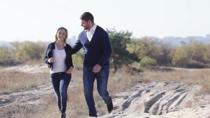 Couple running through woods