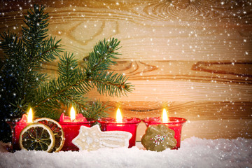 Four Advent Candles and christmas cookies.