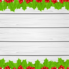 Christmas decoration with holly berry on wooden background