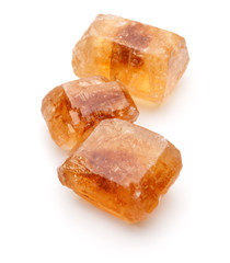 Brown caramelized lump cane sugar cube isolated on white backgro