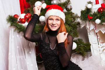 Red-haired girl in the Santa Claus hat