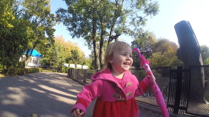 Baby girl running in park