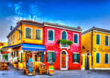 colorful houses in a raw at Burano island near Venice Italy. HDR