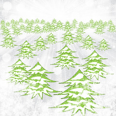 Abstract winter background with trees and snowflakes