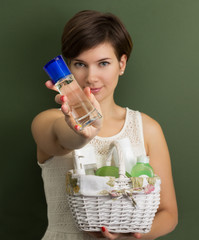 Woman with a basket full of skin care products