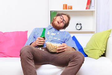 Sleeping at a party with popcorn and beer