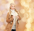 canvas print picture - smiling young woman in winter clothes