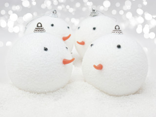 Cute Snowman baubles in snow