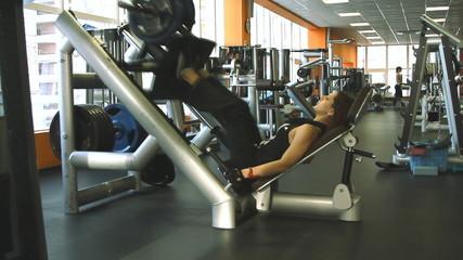 Female exercising their legs on the training