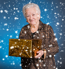 Smiling old woman with present box