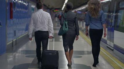Businesspeople walking on platform, slow motion, steadycam