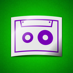 cassette icon sign. Symbol chic colored sticky label on green