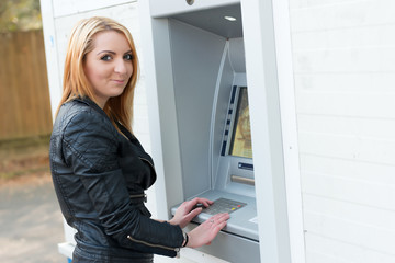 Sexy girl at ATM