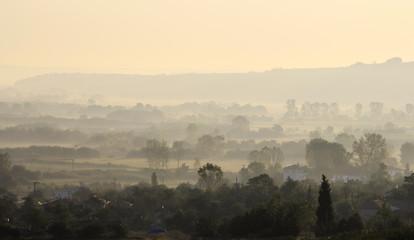 Village in a foggy morning