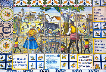 Decorative tiles on Madrid street. National decorative art with