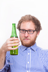 Bearded man with a bottle of beer