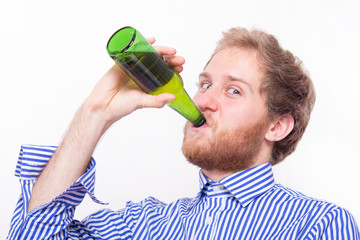 Young man drinking a bottle of beer