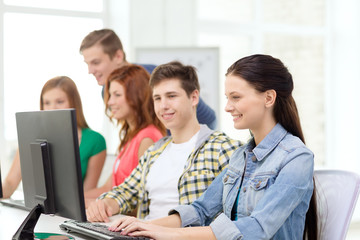 female student with classmates in computer class