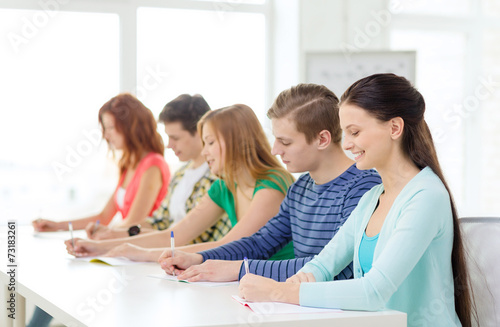 canvas print picture smiling students with textbooks at school