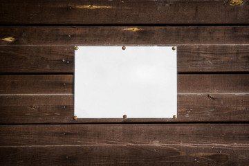 clean empty standard sheet on a wooden wall