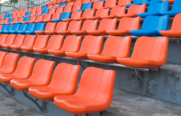 orange and blue grandstand chairs