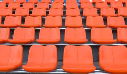 orange grandstand chairs