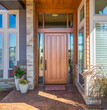 Elegant front door of home with welcome mat