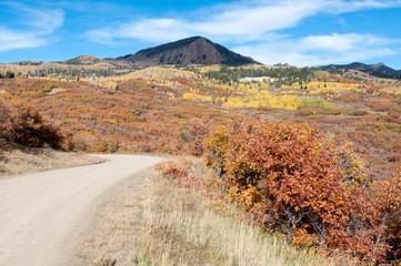 Urban road way to mountain peak, colorado