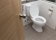 white flush toilet in modern bathroom interior - 73186485