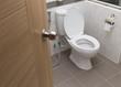 Leinwandbild Motiv white flush toilet in modern bathroom interior