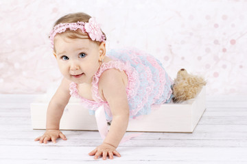 Crawling little baby girl