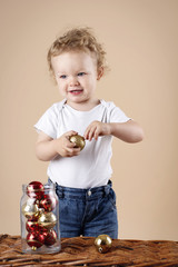Little boy with christmas balls