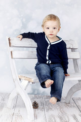 Little boy sitting on the bench