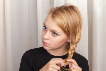 Blond girl braids plait, closeup studio portrait