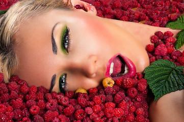 sexy beautiful female face in raspberries