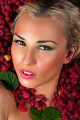 sensual female face in raspberries