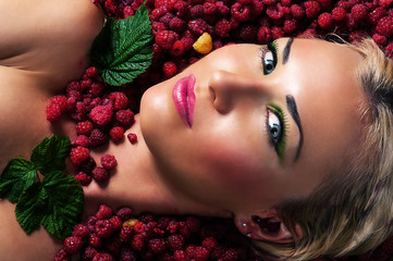 fashion beautiful face in raspberries