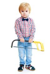 Little boy holding a hacksaw.