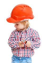 little boy in the construction helmet