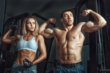 Sports man and woman at the gym.