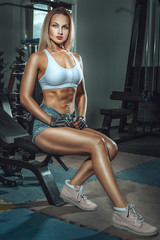 Sports girl in the gym.