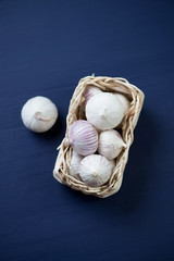 Above view of chinese solo garlic in a traditional wicker tray