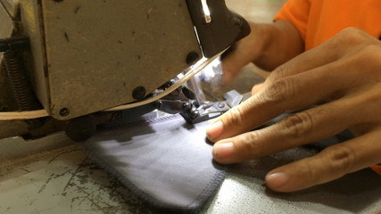 stitching on textile with overlock sewing machine